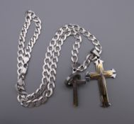 A gentleman's heavy silver chain with two crosses. 55 cm long. 43.1 grammes.