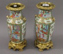 A pair of 19th century Canton vases with ormolu mounts. 41 cm high.