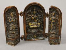 An Eastern bronze triptych. 14 cm high.