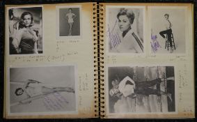 An album containing various signed photographs of mid-20th century actresses and pin ups,