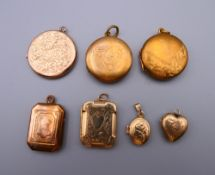 A collection of 9 ct gold front and back, and plated lockets. The 2.5 cm diameter.