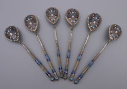Six enamel decorated silver Russian teaspoons. Each 10.5 cm long. 79.4 grammes total weight.
