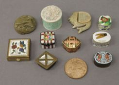 A collection of small enamel and other boxes.