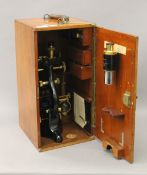 A cased Watson & Sons microscope. The case 44 cm high.