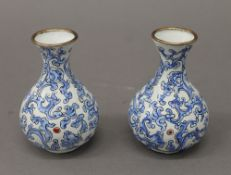 A pair of Chinese enamel vases. 10 cm high.