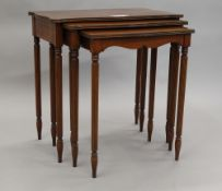 A modern nest of three mahogany tables. 66 cm wide.