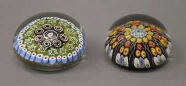 Two rounded millefiori paperweights. The largest 5 cm high.