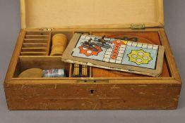 A vintage boxed games compendium. 34 cm wide.