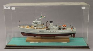 A cased scale model of the mine sweeper HMS Appleton. The case 60.5 cm long.
