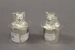 A pair of silver plated cat formed salt and peppers.