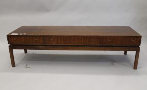 A 20th century coffee table by Greaves and Thomas. 150 cm long.