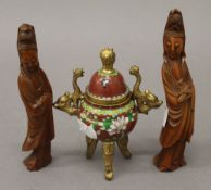 Two 19th century carved wooden figures of Guanyin and a small cloisonne gilded brass censer on