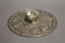 An Arts and Crafts silver plated circular inkwell. 22 cm diameter.