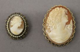 A 9 ct gold mounted cameo brooch and another. The former 4.25 cm high.