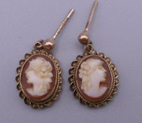A pair of 9 ct gold and cameo earrings. 1.2 cm high. 1.9 grammes total weight.