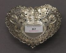 A sterling silver heart shaped dish. 11.5 cm wide. 73.3 grammes.