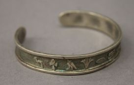 An Egyptian unmarked silver bangle. 6.5 cm wide. 22 grammes.