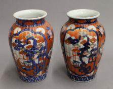 A pair of late 19th century Imari vases. 24 cm high.