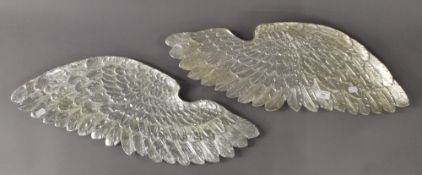 A pair of silvered angel wings. 70 cm wide.