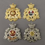 A quantity of military badges.