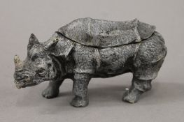 A cold painted bronze rhino inkwell. 15.5 cm long.