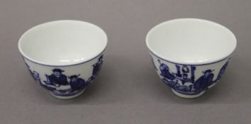 A pair of Chinese blue and white porcelain wine cups. 6.5 cm diameter.