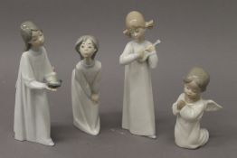 Four Lladro figurines. The largest 20 cm high.