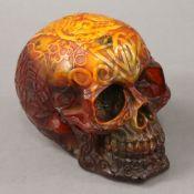 A model of a skull. 13 cm high, 16 cm long, 11 cm wide.