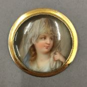 A 19th century circular unmarked gold (tests as 9 ct gold) brooch,