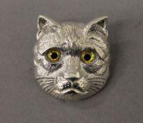 A silver cat brooch. 3 cm high.