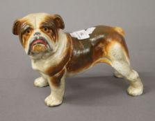 An iron model of a bulldog. 15 cm high.