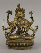A gilt bronze model of a multi-armed deity set with cabochon. 21.5 cm high.
