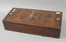 A Georgian mahogany housekeeper's box. 59 cm long.