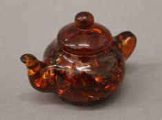 A small model teapot. 7 cm wide.