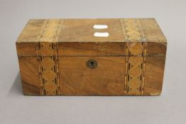 A Victorian inlaid walnut tea caddy. 25 cm wide.