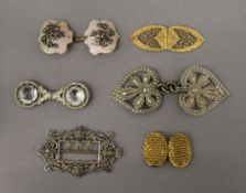 A collection of various vintage buckles