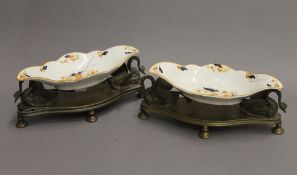 A pair of 19th century porcelain mounted bronze swan form table servers. 28 cm long.