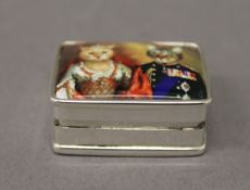 A silver pill box depicting cats. 3 cm wide.