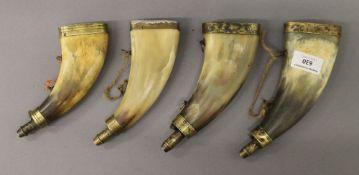 Four 19th century horn powder flasks. The largest 18.5 cm high.