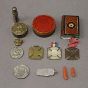 A bag of miscellaneous items, including medals, corals, etc.