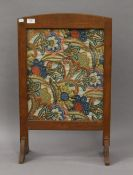 A modern mirror and a tapestry inset firescreen. The latter 73 cm high.