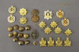 A quantity of military cap badges, etc.