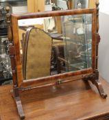 A 19th century mahogany toilet mirror