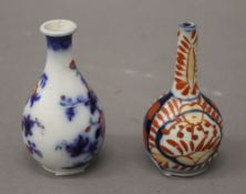 A miniature Japanese Imari vase and another miniature vase. The former 8 cm high.
