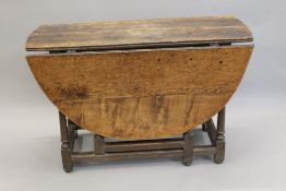 An 18th century oak drop leaf table. 111 cm wide.