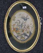 A 19th century floral silk embroidery, housed in an oval frame. 55 cm high overall.