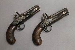 A pair of flintlock man stopper pistols. Each 21 cm long.