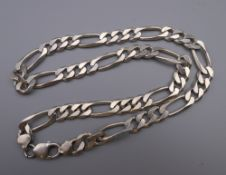 A gentleman's silver figaro necklace. 49 cm long.