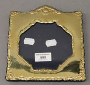 A sterling silver photograph frame with gilt finish. 17 cm wide.