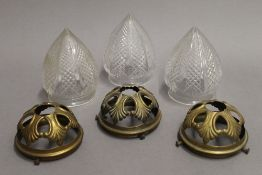 Three cut glass hanging lights, each with brass gallery. 17 cm high.